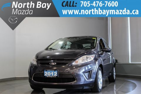 Pre-Owned 2012 Ford Fiesta SE with Bluetooth, Heated Seats, Cruise Control FWD Hatchback
